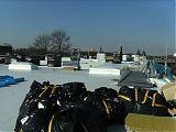 Materiallager auf dem Dach <br />(Isolierung, Rauchabzugshauben, Folien)
